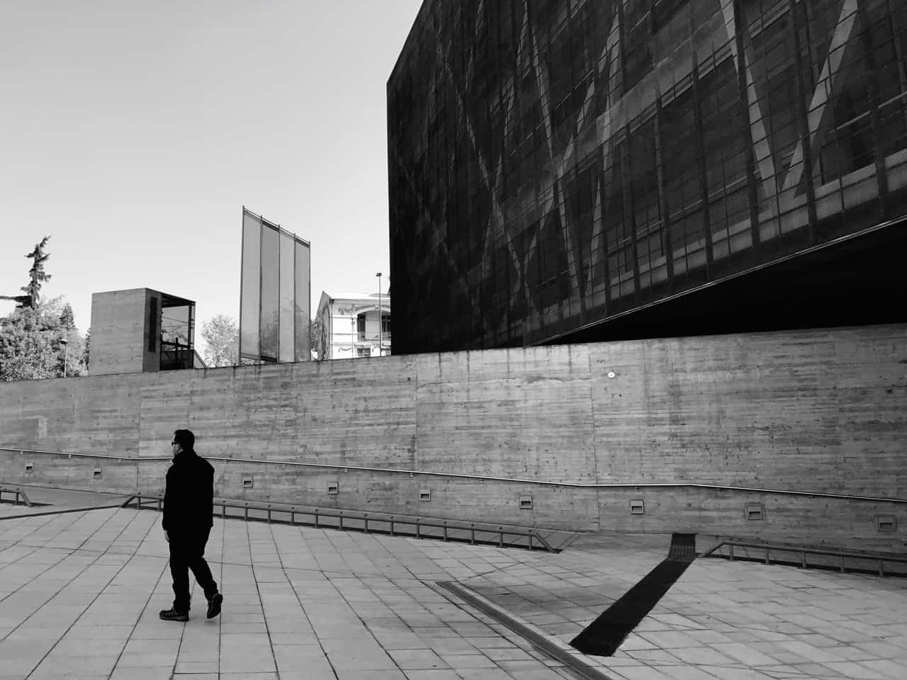Things to do in Santiago - Black and white image of visitor leaving Santiago's Museum of Memory and Human Rights
