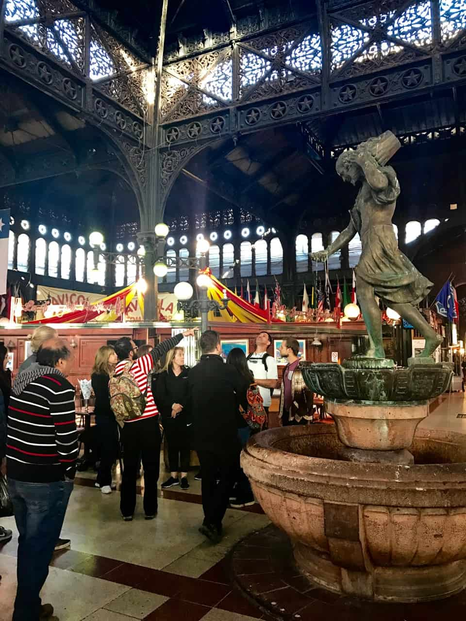 Things to do in Santiago - A Tours4Tips group learns about the Mercado Central in Santiago