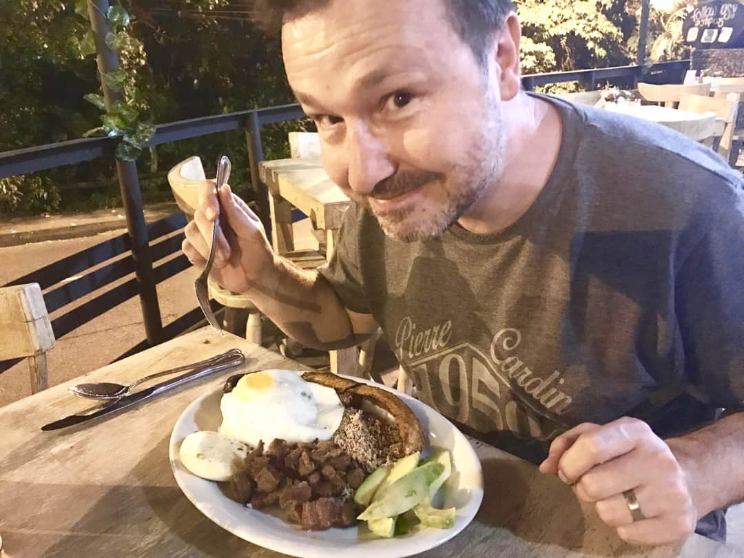 Tucking into Bandeja Paisa, a Colombian food specialty.