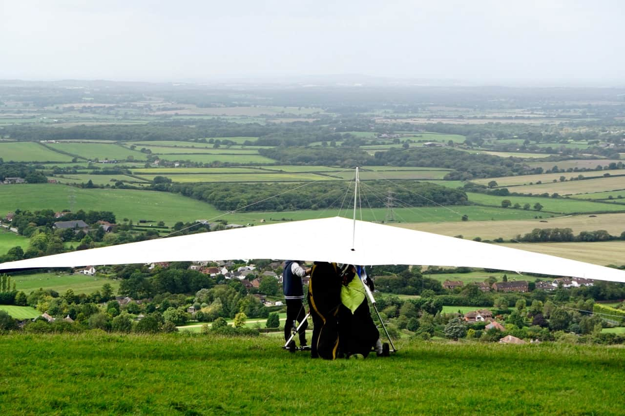 East Sussex Road Trip – a hang glider readies for take off