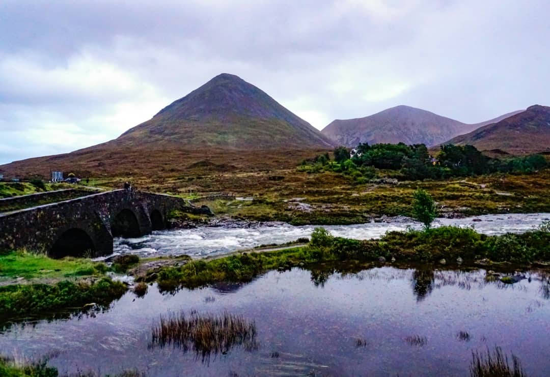 Sligachan Bridge rests in the foreground of the Cuillin Mountains.