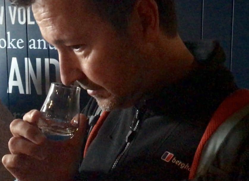 John smells a dram of whisky at Talisker Distillery.