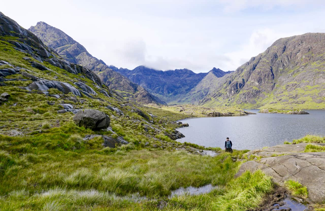 John hikes alongside Loch Coruisk with the Cuillins rising in the background.