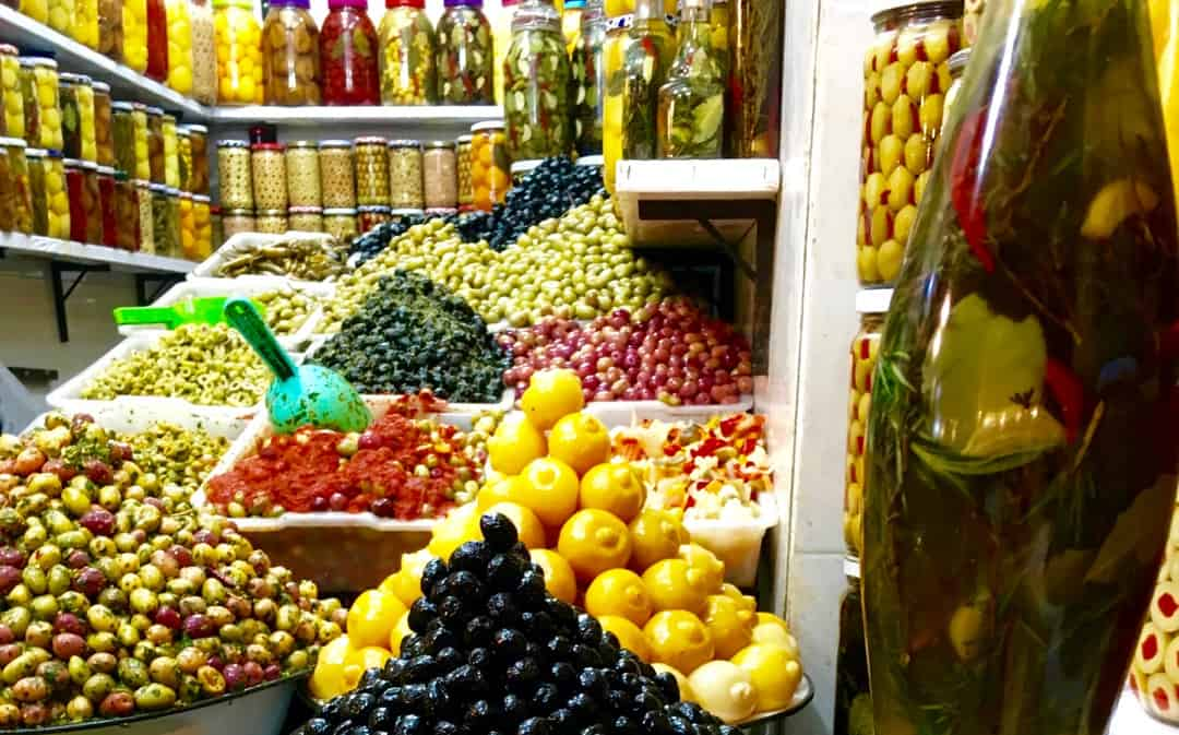 Marrakech old town - local shop selling olives and pickles