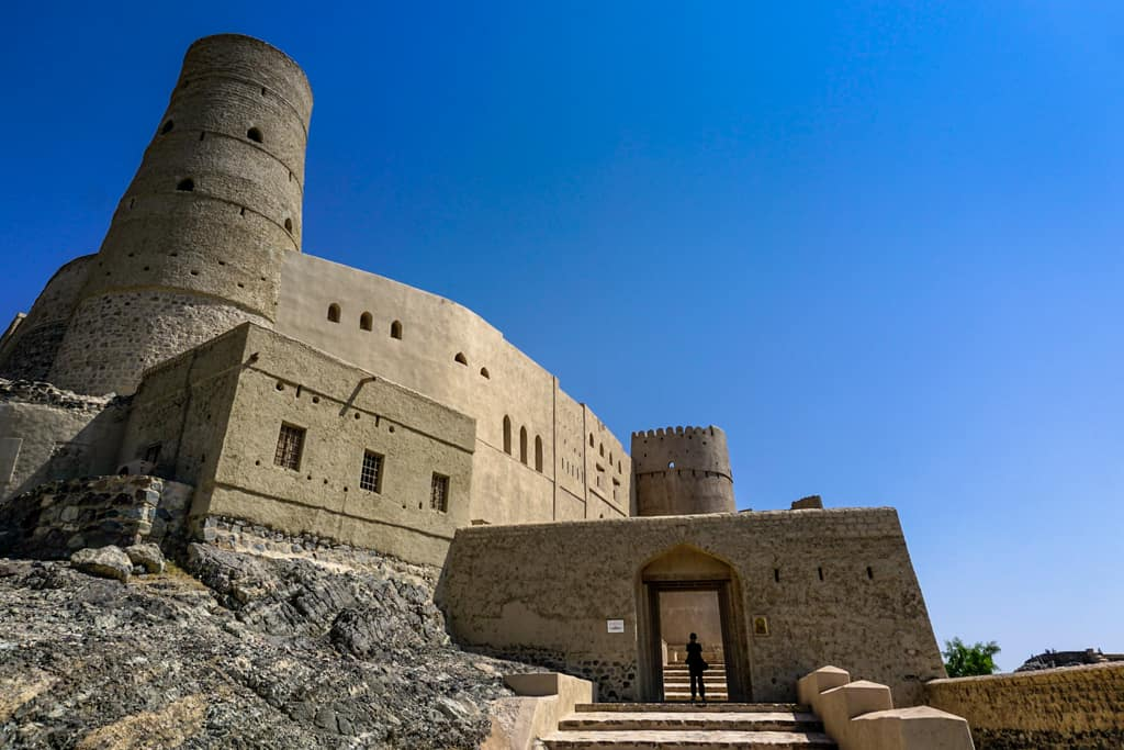 Oman Images – The imposing entrance to the Unesco listed Bahla Fort in Oman.