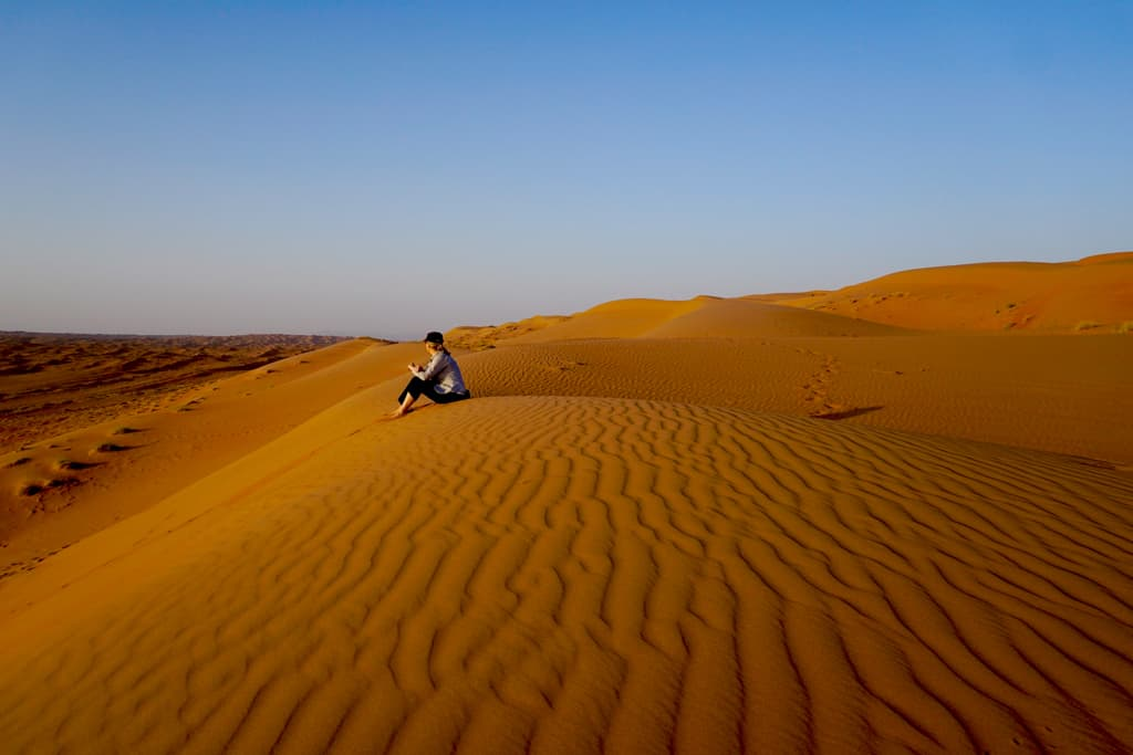 Oman pics – The burnt orange suns of Sharqiyah Sands at sunset are a perfect place to sit quietly and contemplate the world around you.
