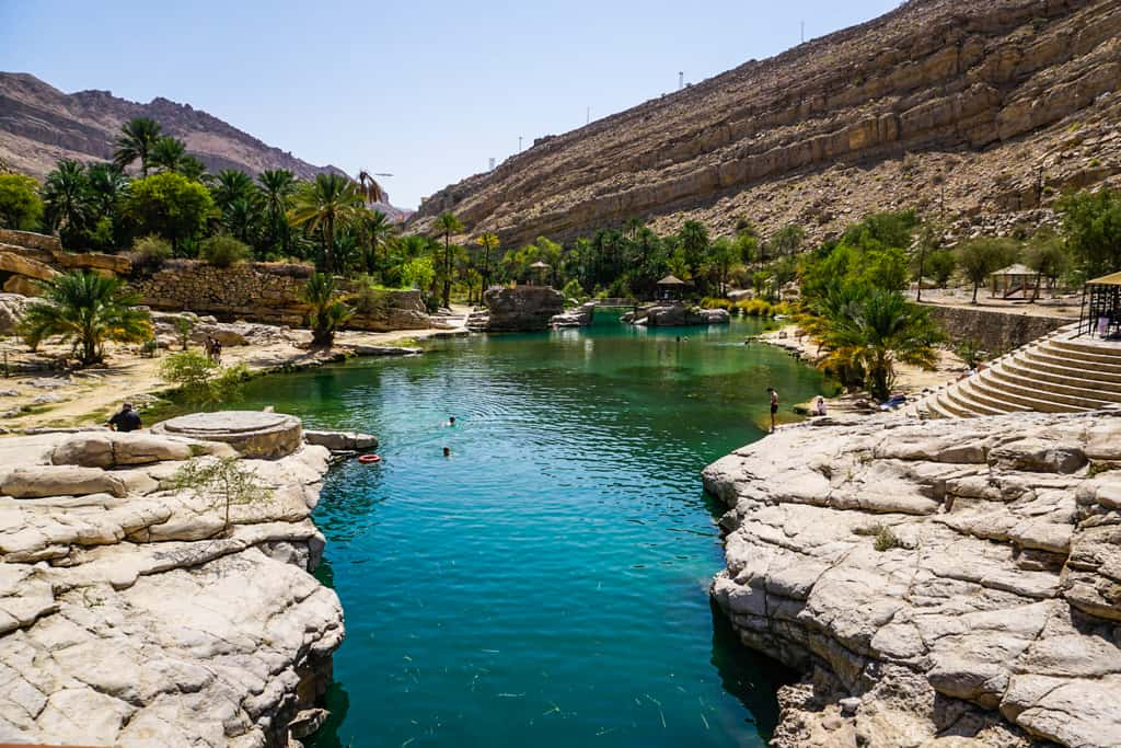 The emerald pools of Wadi Bani Khalid are a perfect place to cool down on a hot day in Oman.
